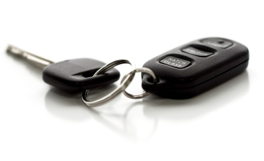 Photograph of car key and remote on a white background
